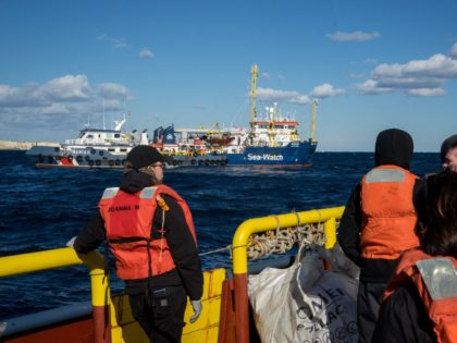 A pictured taken from a boat bringing supplies, a new crew and a delegation of German MPs shows the boat approaching the Dutch-flagged Sea-Watch 3 rescue vessel on January 4, 2019 in the Mediterranean off Malta's coast. - Rights activists accused Europe on January 4, 2019 of clinching a new …
