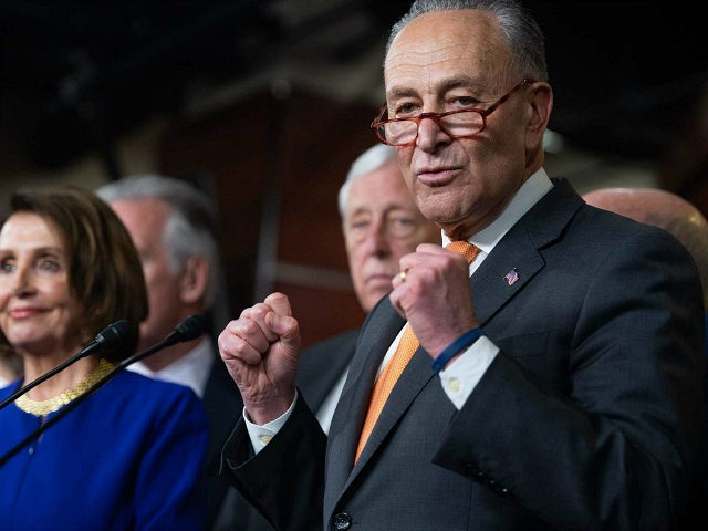 US Speaker of the House Nancy Pelosi (L) and Senate Democratic Leader Chuck Schumer (R) hold a press conference on Capitol Hill in Washington, DC, May 22, 2019, following a meeting with US President Donald Trump at the White House. (Photo by SAUL LOEB / AFP) (Photo credit should read …