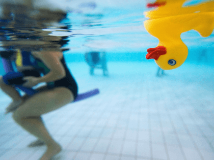 rubber duck floats on the water as toddlers explore the water with their parents during a swimming class for babies at Lane Cove pool March 16, 2007 in Sydney, Australia. As the baby boom in Australia continues, the popularity of swimming classes for babies and toddlers is also on the …