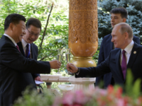 Russian President Vladimir Putin (L) and Chinese President Xi Jinping (R) toast before the fifth regular foreign ministers' meeting of the Conference on Interaction and Confidence Building Measures in Asia (CICA) at the Diaoyutai State Guesthouse in Dushanbe on June 15, 2019. (Photo by Alexei Druzhinin / Sputnik / AFP) …