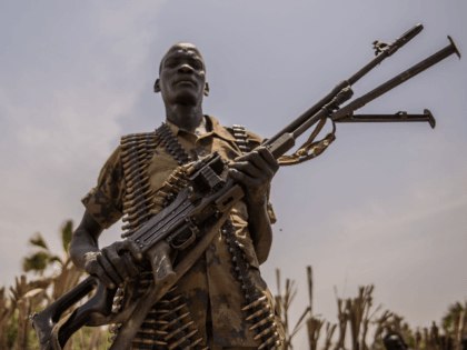 A rebel soldier poses with his gun in Touch Riak, Leer county, on March 7, 2018, where famine has been declared since February 2017. International NGOs have left the area after heavy fighting erupted between the government army, the Sudan People's Liberation Army (SPLA), and the rebels in July 2016, …
