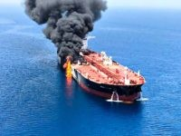 A picture obtained by AFP from Iranian News Agency ISNA on June 13, 2019 reportedly shows fire and smoke billowing from Norwegian owned Front Altair tanker said to have been attacked in the waters of the Gulf of Oman. - Suspected attacks left two tankers in flames in the waters …