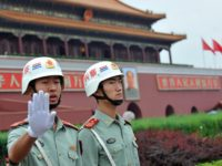 Chinese security personnel ask for no photos to be taken in front of Tiananmen Gate, near Tiananmen Square, one of China's most politically sensitive sites where the military crushed pro-democracy protests in 1989, in Beijing on August 17, 2008. A series of security measures have been implemented by Chinese authorities, …