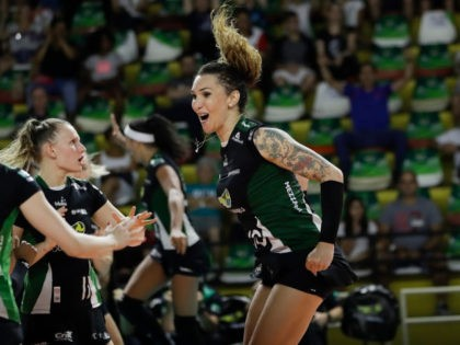 FILE - In this Tuesday, Dec. 19, 2017 file photo, Bauru's volleyball player Tiffany Abreu, right, celebrates with teammates during a Brazilian volleyball league match in Bauru, Brazil. Abreu became the first transgender player in the top women's volleyball league in 2017. Her record-setting performances have rankled Ana Paula Henkel, …