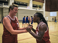 Ugandan transgender player Jay Mulucha (R) speaks with a teammate during the basketball competition at the 2018 Gay Games edition at the Palais des Sports Robert Charpentier in Issy- les-Moulineaux, south of Paris on August 7, 2018. - 32 year-old Jay plays with the Netherlands women's team, was expelled from …