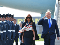 US President Donald Trump (R) and US First Lady Melania Trump (L) walk on the tarmac after disembarking Air Force One at Stansted Airport, north of London on June 3, 2018, as they begin a three-day State Visit to the UK. - Britain rolled out the red carpet for US …