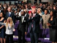Republican presidential nominee Donald Trump isshown during a church service at Great Faith Ministries, Saturday, Sept. 3, 2016, in Detroit. (AP Photo/Evan Vucci)