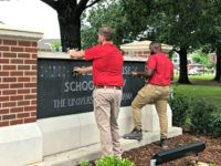 University of Alabama employees remove the name of Hugh F. Culverhouse Jr. off the School of Law sign in Tuscaloosa, Ala., Friday, June 7, 2019. The University of Alabama board of trustees voted Friday to give back a $26.5 million donation to a philanthropist Hugh F. Culverhouse Jr., who recently …