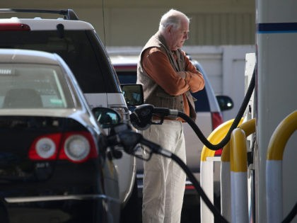 MILL VALLEY, CA - MARCH 03: A customer pumps gasoline into his car at an Arco gas station on March 3, 2015 in Mill Valley, California. U.S. gas prices have surged an average of 39 cents in the past 35 days as a result of the price of crude oil …