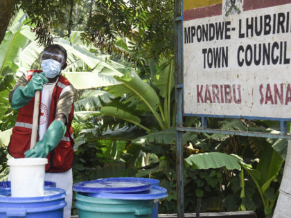 A health worker makes a chlorine solution for sanitisation at the Mpondwe Health Screening Facility in Mpondwe, the Uganda's border town with the Democratic Republic of Congo, on June 13, 2019. - A grandmother in Uganda has died from Ebola, health officials said on June 12, 2019, the second fatality …