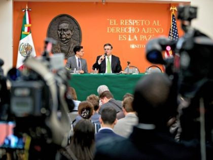 Mexican Foreign Affairs Secretary Marcelo Ebrard, right, speaks at a news conference at the Mexican Embassy in Washington, Tuesday, June 4, 2019, as part of a Mexican delegation in Washington for talks following trade tariff threats from the Trump Administration. (AP Photo/Andrew Harnik)
