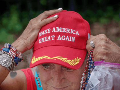 An elderly supporter of US President Donald Trump adjusts her cap as she waits along one of the main streets outside the Amway Center on June 17, 2019 some 40 hours before a Trump campaign event in Orlando, Florida. - President Trump is expected to launch his 2020 re-election campaign …