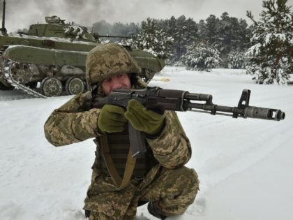 An Ukrainian army reservist aims at a target as he takes part in military exercises in the Army Training Center near the village of Desna, Chernigiv region in northern Ukraine, on December 19, 2018. - Tensions between Ukraine and Russia rosed on November 25, 2018, when Russian forces seized three …