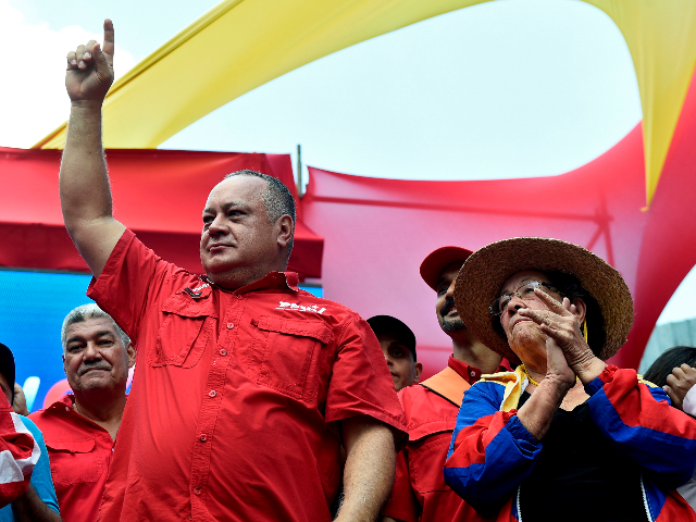 The president of the Venezuelan National Constituent Assembly Diosdado Cabello (L) gestures during a rally called by Venezuelan President Nicolas Maduro in Caracas on April 6, 2019. - Venezuela's opposition leader Juan Guaido urged his supporters to demonstrate in the streets Saturday to maintain pressure on his rival President Nicolas …