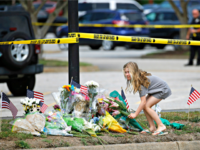 A girl leaves flowers at a makeshift memorial at the edge of a police cordon in front of a municipal building that was the scene of a shooting, Saturday, June 1, 2019, in Virginia Beach, Va. DeWayne Craddock, a longtime city employee, opened fire at the building Friday before police …