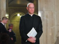 Basilica of the National Shrine of the Immaculate Conception Rector Monsignor Walter Rossi arrives for a press conference to introduce Notre Dame de Paris organist Johann Vexo in the Basilica in Washington, DC on April 25, 2019. - The Basilica will be hosting a concert to benefit the Cathedral of …