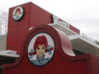 This March 17, 2014, file photo shows a Wendy's logo outside a Wendy's restaurant in Pittsburgh. Wendy's reports financial results Wednesday, Feb. 21, 2018. (AP Photo/Gene J. Puskar)