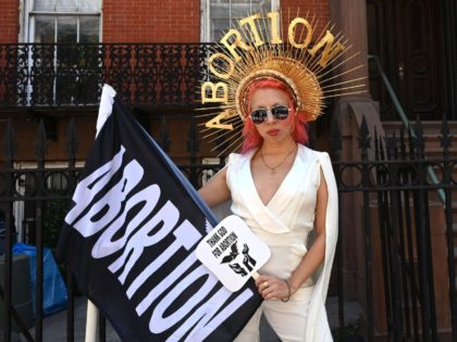 """Viva Ruiz from """"Thank God For Abortion"""" poses for a photo as she takes part in an abortion rights rally in front of the Middle Collegiate Church in the East Village of New York on May 21, 2019. - Demonstrations were planned across the US on Tuesday in defense of …"""