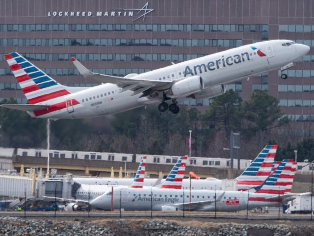 A Boeing 737 flown by American Airlines passes by the Lockheed Martin building as it takes off from Ronald Reagan Washington National Airport in Arlington, Virginia on March 11, 2019. (Photo by Andrew CABALLERO-REYNOLDS / AFP) (Photo credit should read ANDREW CABALLERO-REYNOLDS/AFP/Getty Images)