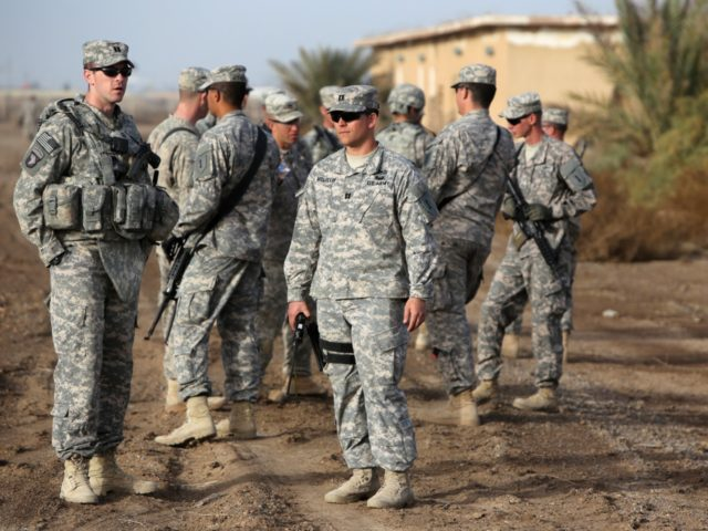 American trainers take a break as they train Iraqi soldier on approaching and clearing buildings at the Taji base complex, which hosts Iraqi and US troops and is located north of the capital Baghdad, on January 7, 2015. Taji is one of an eventual five sites from which the US …