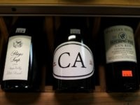 LOS ANGELES, CA - FEBRUARY 14: Bottles of California wines are displayed on a shelf at John and Pete's Fine Wine and Spirits on February 14, 2017 in Los Angeles, California. Exports of U.S. wines, specifically from California, increased by one percent to a record high of $1.62 billion in …