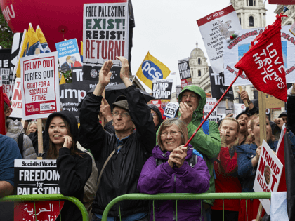 LONDON, UNITED KINGDOM - JUNE 4: Anti-Trump protestors demonstrate in Whitehall on June 4, 2019 in London, England. The second day of President Trump's state visit to the United Kingdom was met by further protests in London, as he met with outgoing Prime Minister Theresa May and members of her …