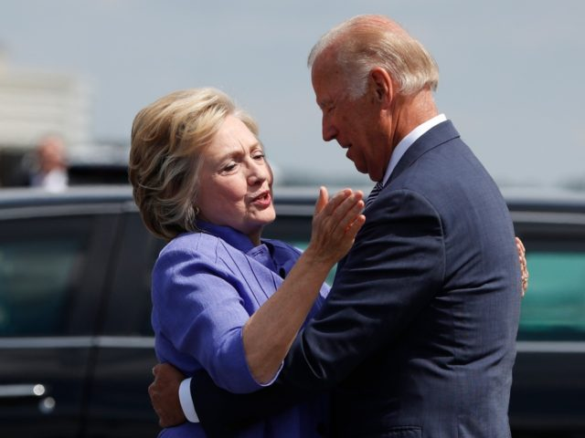 Democratic presidential candidate Hillary Clinton greets Vice President Joe Biden on the tarmac at Wilkes-Barre/Scranton International Airport in Avoca, Pa., Monday, Aug. 15, 2016, before traveling together to a campaign event in Scranton, Pa. (AP Photo/Carolyn Kaster)