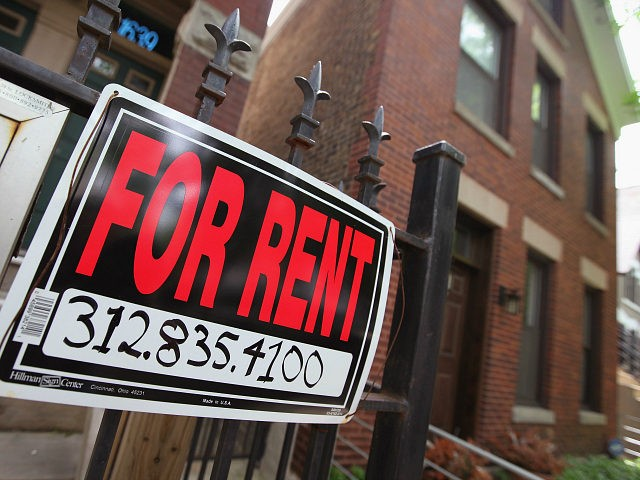 "CHICAGO, IL - MAY 31: A ""For Rent"" sign stands in front of a house on May 31, 2011 in Chicago, Illinois. According to the Standard & Poor's Case-Shiller Home Price Index home prices fell in March in 18 of the 20 metropolitan areas monitored by the index, reaching their …"