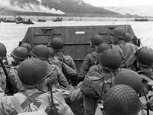 American assault troops in a landing craft huddle behind the shield 06 June 1944 approaching Utah Beach while Allied forces are storming the Normandy beaches on D-Day. D-Day, 06 June 1944 is still one of the world's most gut-wrenching and consequential battles, as the Allied landing in Normandy led to …