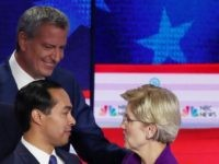 MIAMI, FLORIDA - JUNE 26: (L-R) Sen. Cory Booker (D-NJ), New York City Mayor Bill De Blasio, former housing secretary Julian Castro and Sen. Elizabeth Warren (D-MA) shake hands after the first night of the Democratic presidential debate on June 26, 2019 in Miami, Florida. A field of 20 Democratic …