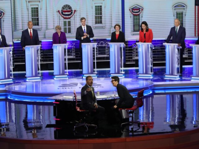 MIAMI, FLORIDA - JUNE 26: Chuck Todd of NBC News and Rachel Maddow of MSNBC and candidates react to technical difficulties during the first night of the Democratic presidential debate on June 26, 2019 in Miami, Florida. A field of 20 Democratic presidential candidates was split into two groups of …
