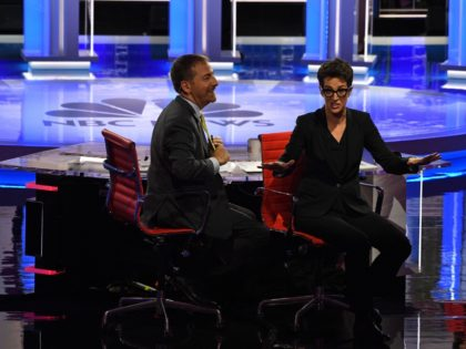 Moderators Chuck Todd (L) and Rachel Maddow speak to audience during a technical problem as they host the first night of the Democratic presidential primary debate hosted by NBC News at the Adrienne Arsht Center for the Performing Arts in Miami, Florida, on June 26, 2019. (Photo by JIM WATSON …