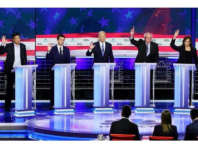 MIAMI, FLORIDA - JUNE 27: Democratic presidential candidates (L-R) former tech executive Andrew Yang, South Bend, Indiana Mayor Pete Buttigieg, former Vice President Joe Biden, Sen. Bernie Sanders (I-VT) and Sen. Kamala Harris (D-CA) raise their hands during the second night of the first Democratic presidential debate on June 27, …