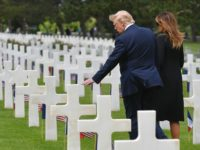 US President Donald Trump (L) and US First Lady Melania Trump (R) visit graves after a French-US ceremony at the Normandy American Cemetery and Memorial in Colleville-sur-Mer, Normandy, northwestern France, on June 6, 2019, as part of D-Day commemorations marking the 75th anniversary of the World War II Allied landings …