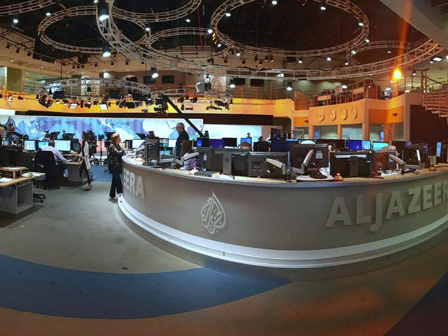 In this Thursday, June 8, 2017 photo, Al Jazeera staff work at their TV station in Doha, Qatar. The Arab news network Al-Jazeera has been thrust into the center of the story this week as Qatar came under virtual siege by its Gulf neighbors, pressuring it to shut down the …