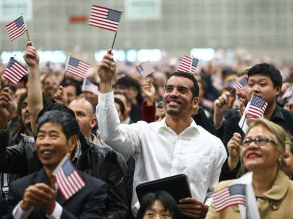 LOS ANGELES, CA - MARCH 20: New U.S. citizens wave American flags at a naturalization ceremony on March 20, 2018 in Los Angeles, California. The naturalization ceremony welcomed more than 7,200 immigrants from over 100 countries who took the citizenship oath and pledged allegiance to the American flag. During FY …