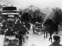 May 1941: A German military convoy overtakes a group of Greek peasants on a rural track during the early stages of the German occupation of Greece. (Photo by Keystone/Getty Images)
