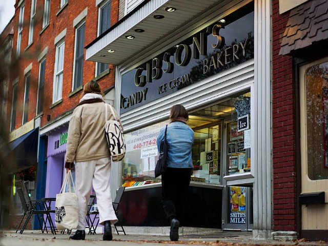 In this Nov. 22, 2017 photo, pedestrians pass the storefront of Gibson's Food Mart & Bakery in Oberlin, Ohio. A long relationship between one of Americas most liberal colleges and 132-year-old family-owned Gibson's is in tatters amid student allegations of racial profiling. The bakery filed a lawsuit last month accusing …
