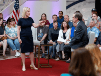 Democratic presidential candidate Sen. Kirsten Gillibrand speaks with FOX News Anchor Chris Wallace, right, during a FOX News town hall, June 2, 2019, in Dubuque, Iowa.