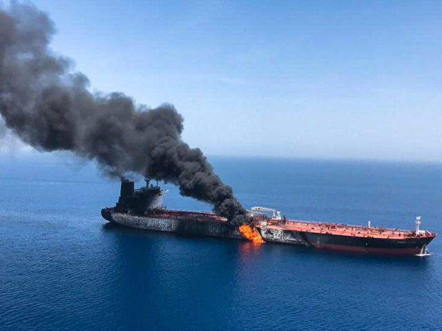 An oil tanker is on fire in the sea of Oman, Thursday, June 13, 2019. Two oil tankers near the strategic Strait of Hormuz were reportedly attacked on Thursday, an assault that left one ablaze and adrift as sailors were evacuated from both vessels and the U.S. Navy rushed to …