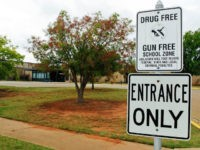 A sign declaring Stillwater Junior High School as a drug free and gun free zone is pictured outside the school in Stillwater, Okla., Wednesday, Sept. 26, 2012. A 13-year-old student shot and killed himself in a hallway at the schooll before classes began Wednesday, police said, terrifying teenagers who feared …