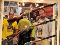Convention attendees look at Henry rifles at the 2015 NRA Annual Convention in Nashville, Tennessee on April 10, 2015. The annual NRA meeting and exhibit, expected to draw over 70,000 people, runs till April 12. AFP PHOTO / KAREN BLEIER (Photo credit should read KAREN BLEIER/AFP/Getty Images)
