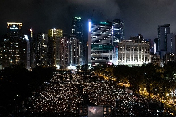 People attend a candlelight vigil at Victoria Park in Hong Kong on June 4, 2019, to mark the 30th anniversary of the 1989 Tiananmen crackdown in Beijing. - The semi-autonomous financial hub has hosted an annual vigil every year since tanks and soldiers smashed into protesters near Beijing's Tiananmen Square on June 4, 1989 -- an illustration of the city's unusual freedoms and vibrant political scene. (Photo by Philip FONG / AFP) (Photo credit should read )
