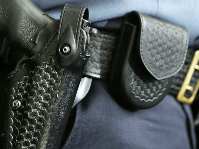 A handgun sits in the holster that belongs to a law enforcement officer during a news conference July 26, 2012 at the National Press Club in Washington, DC. The news conference was to announce a call for expanding background checks for firearm purchasers and banning high-capacity ammunition magazines. (Photo by …