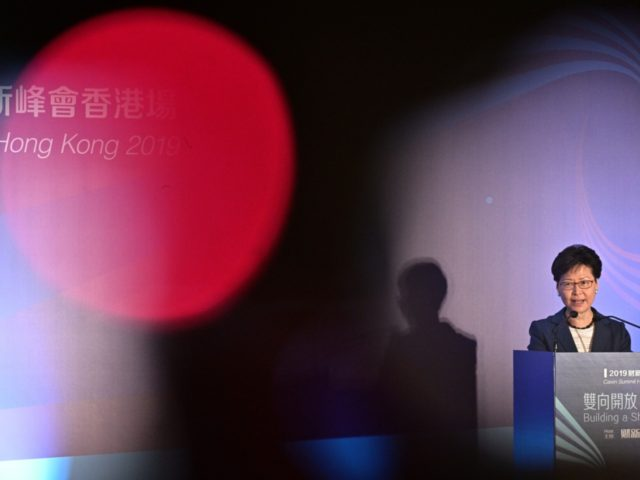 Hong Kong Chief Executive Carrie Lam speaks at the Caixin Summit in Hong Kong on June 10, 2019. - A huge peaceful protest in Hong Kong against controversial plans to allow extraditions to the Chinese mainland descended into violence early on June 10, as police fought running battles with small …
