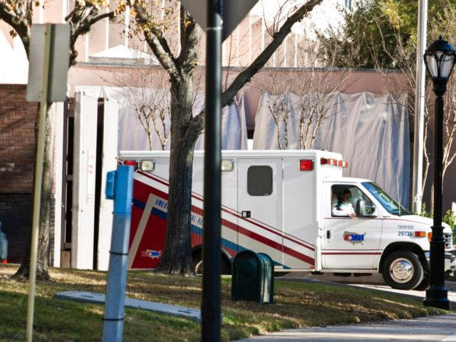 HOUSTON, TX - JANUARY 26: An ambulance, with husband Mark Kelly in the passenger seat, transfers U.S. Rep. Gabrielle Giffords (D-AZ) from the ICU at Memorial Hermann Hospital to the Texas Institute of Rehabilitation and Research (TIRR) to begin her long-term rehabilitation following a gunshot wound at close range to …