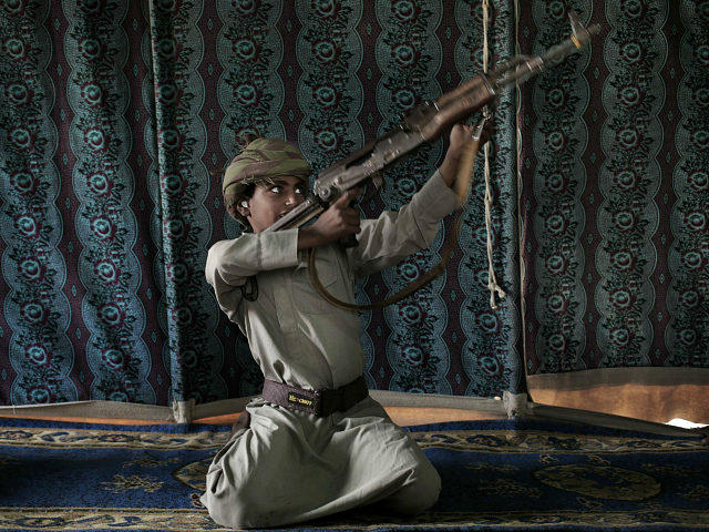 Kahlan, a 12-year-old former child soldier, demonstrates how to use a weapon, at a camp for displaced persons where he took shelter with his family, in Marib, Yemen in this July 27, 2018 photo. Houthi rebels took Kahlan and his classmates, promising to give them new school bags, but instead …