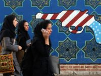 TO GO WITH AFP STORY BY STUART WILLIAMS: Iranian students walk past an anti-US mural on the wall of the former US embassy in Tehran 24 October 2007. Twenty-eight years ago, 19-year-old Iranian chemistry student Massoumeh Ebtekar agreed to join other students in holding more than 60 Americans captive at …