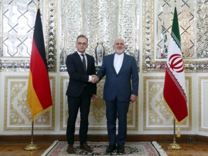 Iranian Foreign Minister Mohammad Javad Zarif, right, and his German counterpart Heiko Maas shake hands for the media prior to their meeting, in Tehran, Iran, Monday, June 10, 2019. (AP Photo/Ebrahim Noroozi)