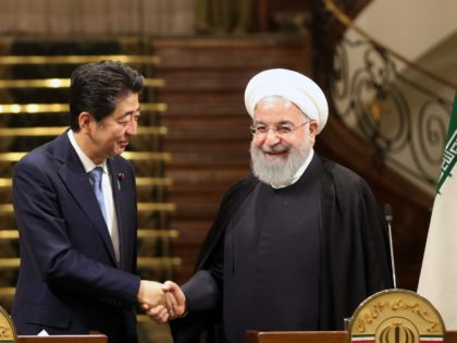 Iranian President Hassan Rouhani (R) shakes hands with Japanese Prime Minister Shinzo Abe, at the Saadabad Palace in the capital Tehran on June 12, 2019. - Abe arrived in Tehran on June 12 for a rare diplomatic mission, hoping to defuse tensions between the Islamic republic and Tokyo's ally Washington. …